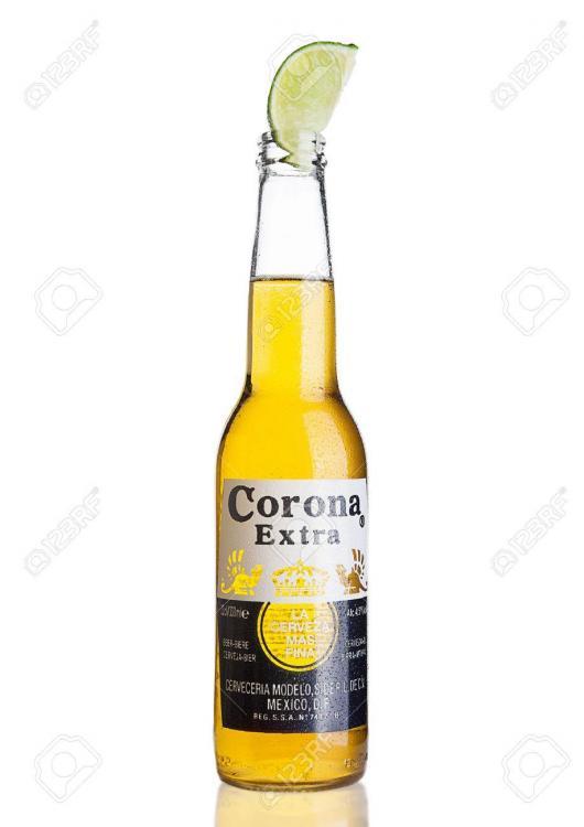 64795971-london-united-kingdom-november-04-2016-bottle-of-corona-extra-beer-with-lime-slice-corona-produced-b.jpg